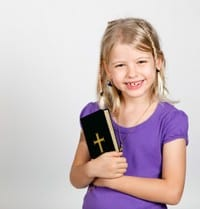 Young girl holding a Bible