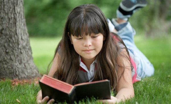 Preteen girl reading Bible